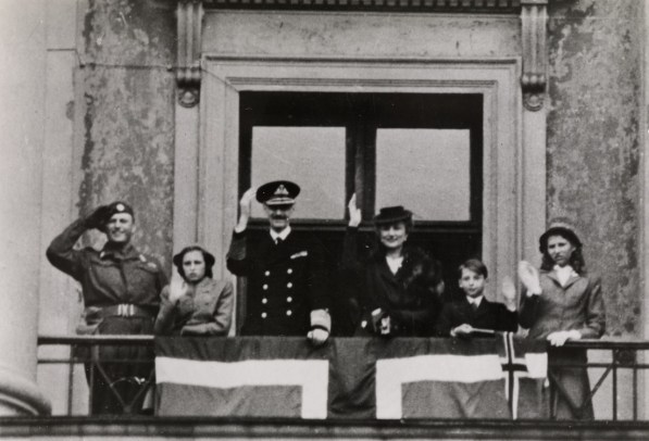 From the left: King Olav, Princess Astrid, King Haakon, Crown Princess Martha, King Harald and Princess Ragnhild. From the balcony of the castle in Oslo the day the Norwegian royal family returned home after five years in exile.