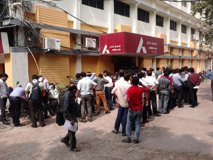 People standing in queues outside Axis bank
