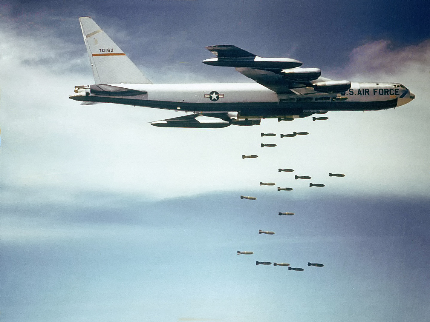 Carpet bombing   Wikipedia Against a blue sky with white clouds  a B 52F releases bombs over Vietnam