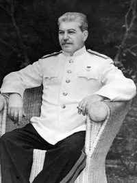 Joseph Stalin, seated outdoors at Berlin confe...