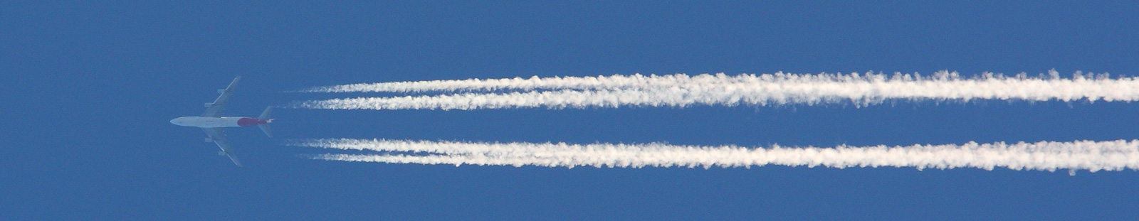 Plane leaving contrails behind. Note how the vapor lines up exactly with the engines.