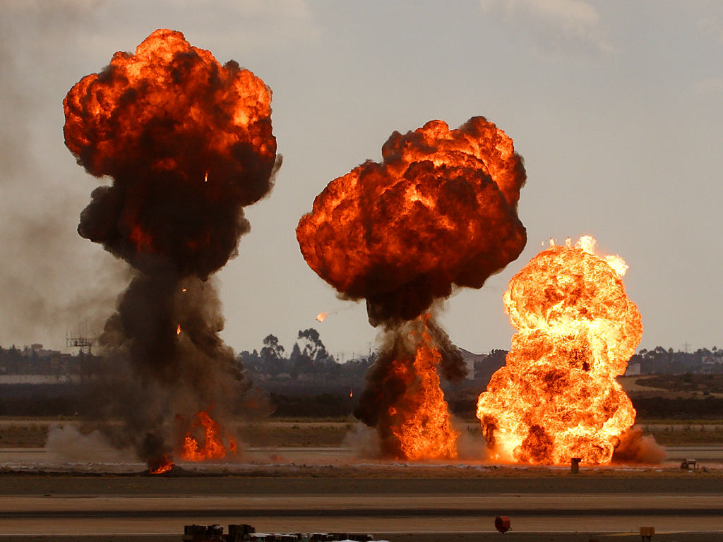 Gasoline explosions, simulating bomb drops at ...