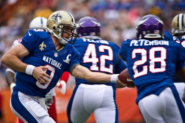Image result for adrian peterson drew brees