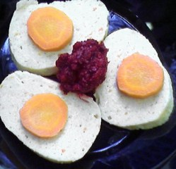 Gefilte fish, served with horseradish and carrot (Wikipedia.org)