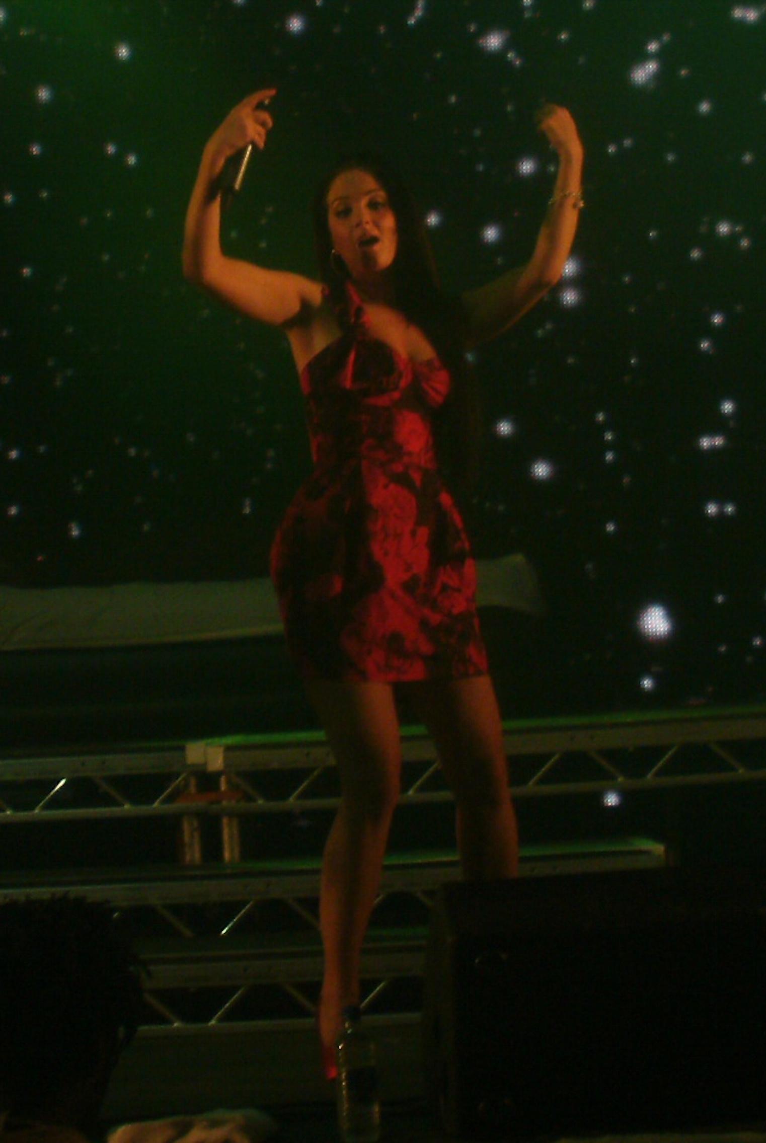 Tulisa performing onstage with N-Dubz in 2010