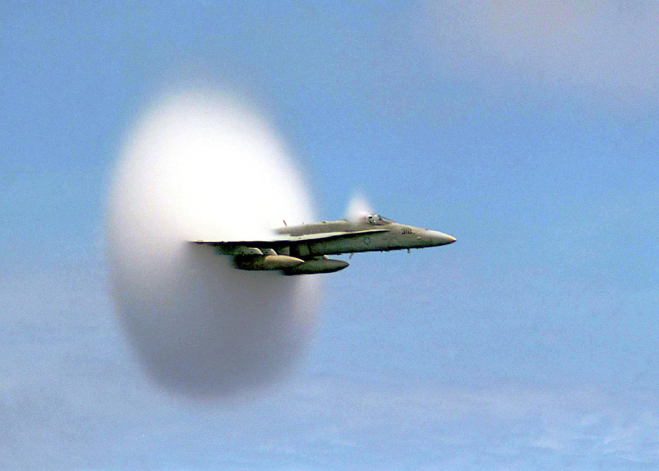 A FA‑18 Hornet breaks the sound barrier