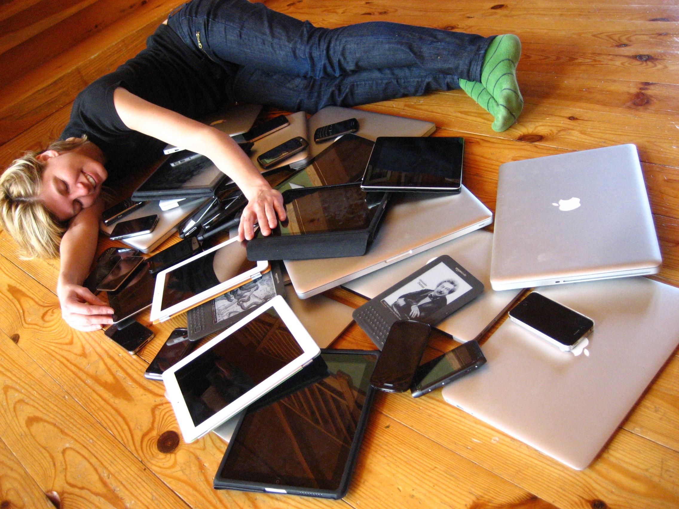 English: A woman cuddling a pile of digital de...