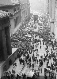 A solemn crowd gathers outside the Stock Exchange after the crash of 1929 (Wikipedia commons).