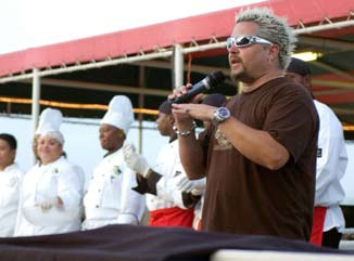 English: Food Network star Guy Fieri introduce...