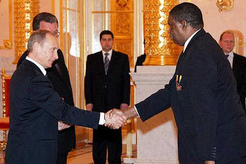 Phelekezela Mphoko shaking hands with Vladmir Putin