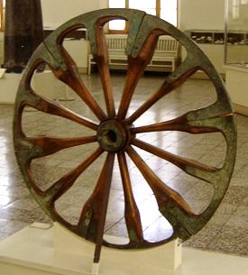 An ancient spoked wheel on exhibit in the Luri...