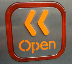 http://upload.wikimedia.org/wikipedia/commons/e/eb/Open_door_button_1996_Stock_(cropped).jpg