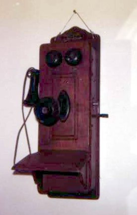 Antique wooden wall telephone with hand crank