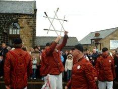 Modern sword dancers holding up a sword lock