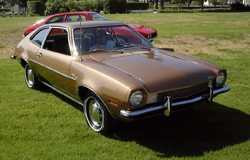 Ford Pinto. Foreground car is a restored examp...