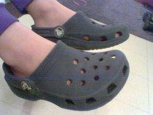 A boy wearing Crocs