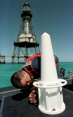 A United States Coast Guard technician prepare...