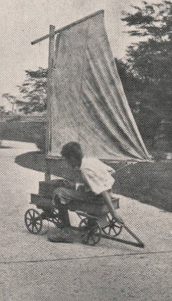 Boy riding on self-made sailboat wagon. By Upper Arlington Community (Ohio) [Public domain], via Wikimedia Commons.