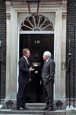 Tony Blair and Dick Cheney at the main door to...