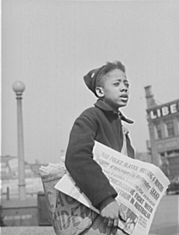 Newsboy selling the Chicago Defender