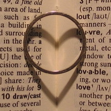 The photographer's wedding ring and its heart-...