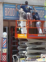 The production crew converts a storefront in downtown New Haven, Connecticut to be used in a scene set to take place in the 1950s.