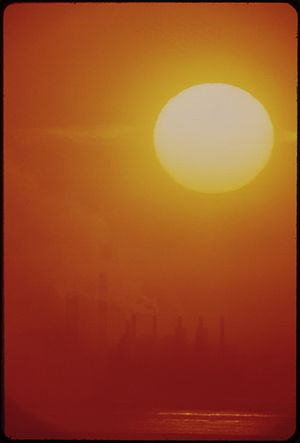 SMOG MAKES DISTORTING LENS FOR THE RISING SUN ...