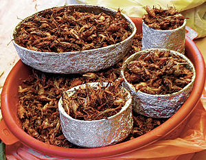 A basket of Chapulines (Roasted Cricket) in a ...