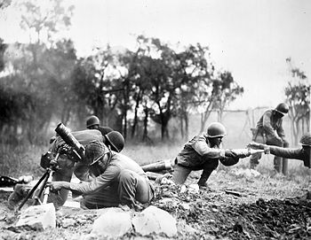 Soldiers of the 92nd Infantry Division operate...
