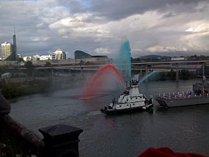 Fireboat spraying colored water Arrival of the...
