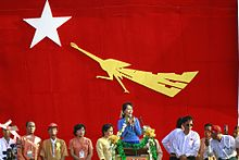 Aung San Suu Kyi (Center) gives a speech to the supporters during the 2012 by-election campaign at her constituency Kawhmu township, Myanmar on 22 March 2012.