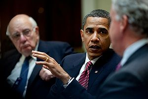 President Barack Obamaa, flanked by Paul Volck...