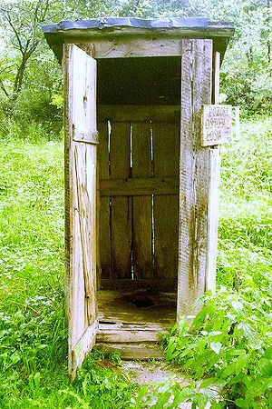 Squat outhouse (i.e. without seat) in Poland