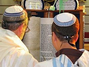 Boy reading from the Torah according to Sephar...