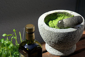 this is a picture of self made pesto in a mortar.