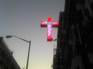 "English: A ""Jesus Saves"" neon cross ..."