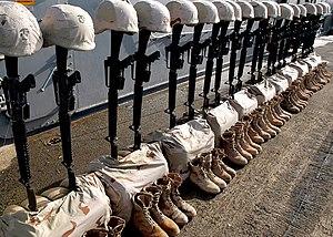 US Navy 030526-N-4048T-025 Memorial saluting 2...