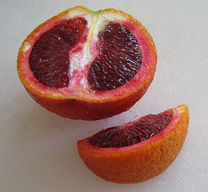 A blood orange, sliced to show the flesh