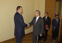 U.S. Secretary of Defense Donald Rumsfeld is greeted by Ilham Aliyev, August 2004
