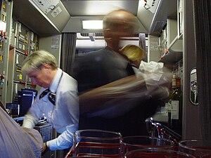 English: Busy Lufthansa flight-attendants in k...