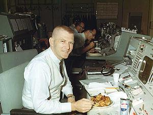 English: Gene Kranz working at his flight dire...