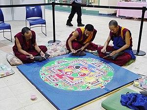Monks working on Sand Mandala at Nashua High S...