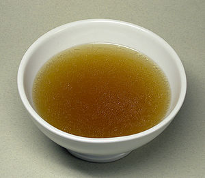 Consommé, a concentrated broth from beef, minc...