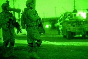As seen through a night vision device, U.S. Ar...