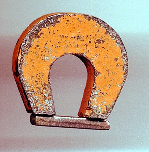A magnet made of alnico, an iron alloy. Ferrom...