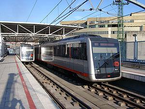 English: Two trains of Metro Bilbao at Bolueta...