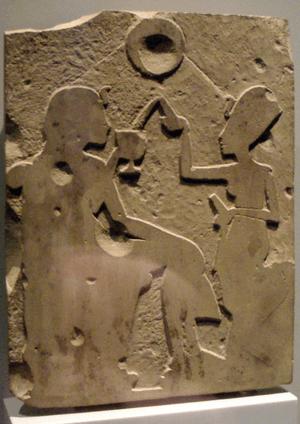 Unfinished stele depicting Nefertiti pouring w...