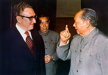 Henry Kissinger and Chairman Mao, with Zhou En...