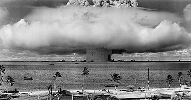 Mushroom-shaped cloud and water column from the underwater nuclear explosion of July 25, 1946. Photo taken from a tower on Bikini Island, 3.5mi (5.6km) away.