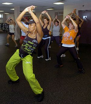 Andrea Knight, Zumba instructor, leads her cla...